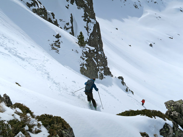 Will picks his way down a steep col