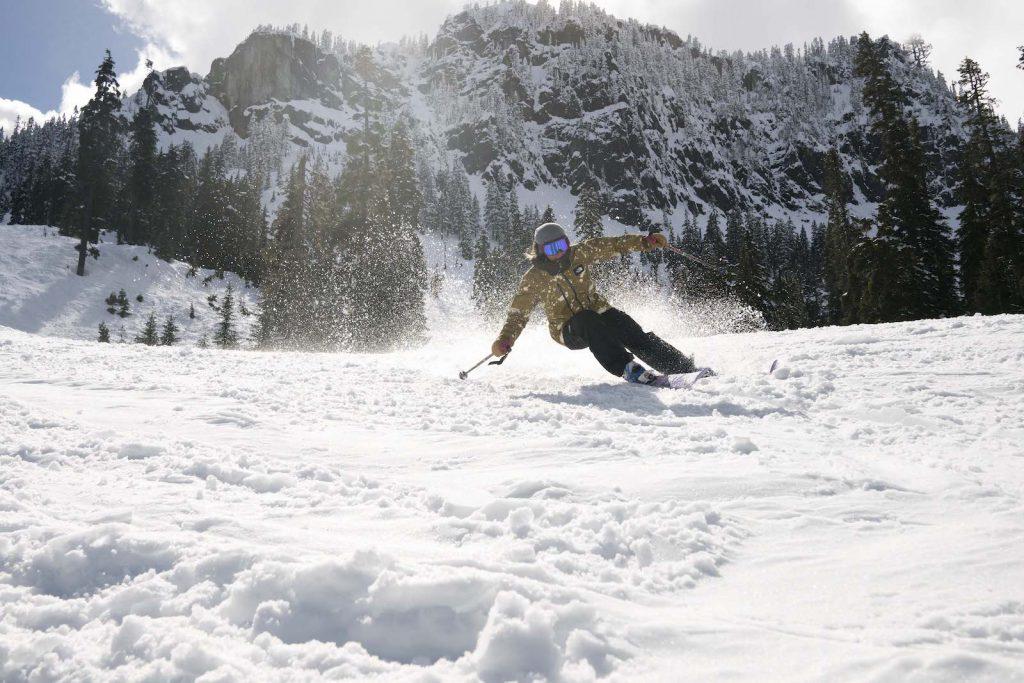 Skiing offpiste spring snow on the 2018 Line Pandora 95